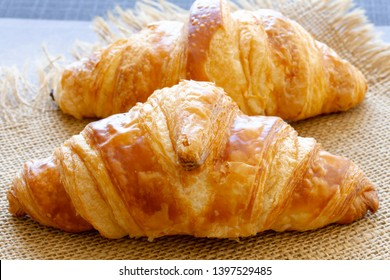 croissant and chocolate croissant on burlap