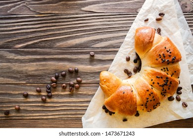 croissant and coffee beans on a textured wooden background top view, cozy and delicious Breakfast. Rustic background with copy space.