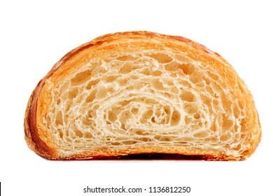 Croissant cut in a half. Homemade fresh golden croissant isolated on white background