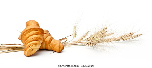 Croissant and ears on white background
