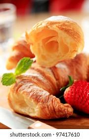 Croissant with fresh strawberries
