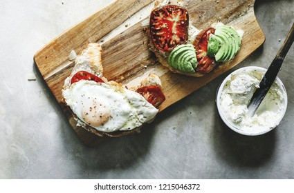 Croissant with heirloom tomato, avocado, and a fried egg