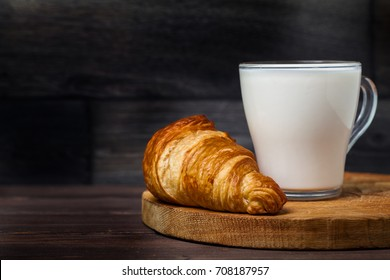 croissant, milk, table wood