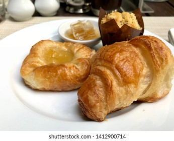 croissant on plate with various of bekery stuff for breakfast