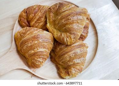 Croissant on wood table