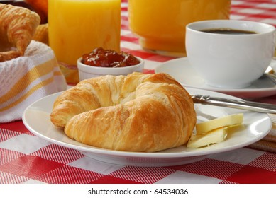 A croissant and orange juice with coffee
