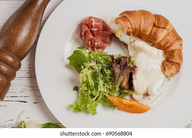 Croissant with salad and bacon