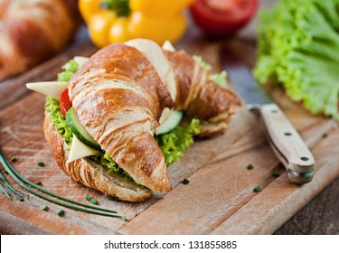 croissant with salad, cheese and tomatoes