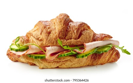 croissant sandwich with ham and cucumber isolated on white background