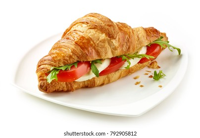 croissant sandwich with tomato and mozzarella isolated on white background