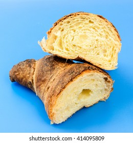 croissant separately on a blue background