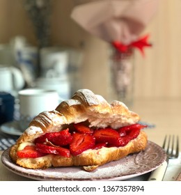 Croissant with strawberry and cream