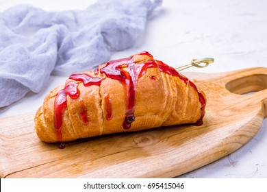 Croissant with strawberry topping