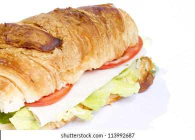 Croissant stuffed with ham and tomato