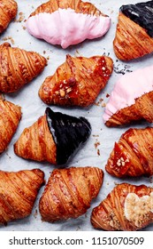 Croissants Background. Fresh homemade croissants with various toppings. Top view. Collection.
