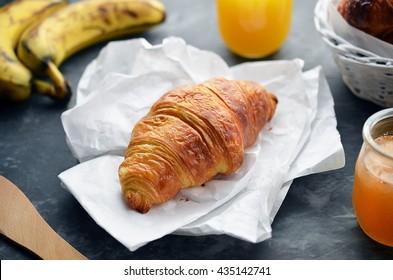 Croissants for breakfast on wooden planks