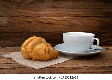 Croissants and Coffee  on old wooden.