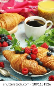 Croissants with fresh berries for breakfast
