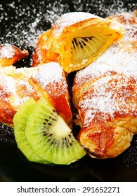 Croissants with kiwi fruit and caster sugar