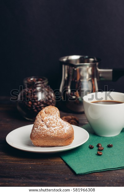 croissants on a plate, mug of coffee on a yellow napkin.
