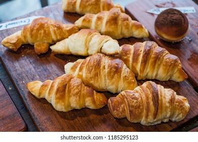 croissants on wooden board