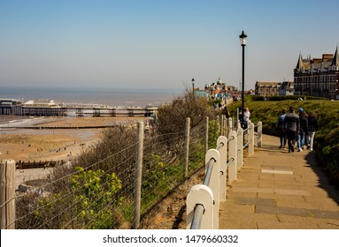 Cromer, Norfolk, UK – April 19 2019. The Norfolk coastal path runs along the cliff tops in Cromer and is a popular path for tourists.