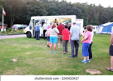 Cromer, Norfolk, UK. September 21, 2016.  Campers at a caravan park queueing for fish and chips from the mobile van at Cromer in Norfolk, UK.