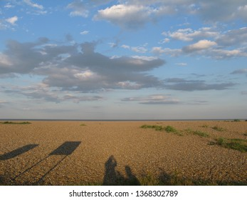 Cromer, Norlfolk/UK: beach and distant ship with shadows.