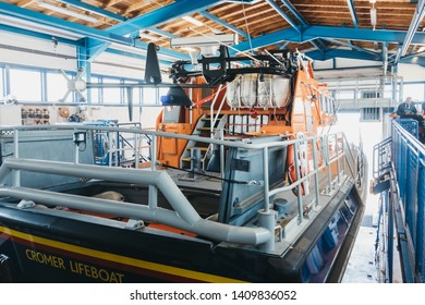 Cromer, UK - April 20, 2019: Lifeboat inside RNLI Lifeboat station in Cromer, Cromer is a seaside town in Norfolk and a popular family holiday destination in UK.
