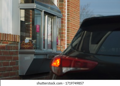 Cromwell, CT / USA - November 25, 2019: SUV making a pit stop at a local Dunkin for coffee