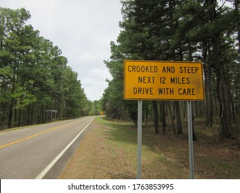 """A """"crooked and steep"""" road warning sign in the Ouachita mountains of Mena, Arkansas - Shutterstock ID 1763853995"""