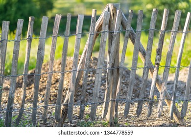 A crooked wooden fence. Background.