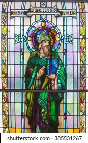 CROOM, IRELAND - CIRCA FEBRUARY 2016 - St Patrick, the patron saint of Ireland. A detail of a stained glass window in a parish church.