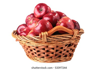 The crop of apples is collected in a wattled basket, a background white.