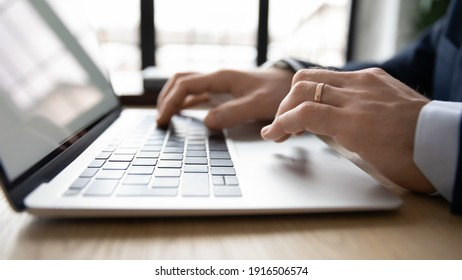 Crop close up of male CEO or employee work distant on laptop write email letter to business partner or client. Businessman use computer consult customer online on gadget in office. Technology concept.