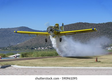 Crop duster dumping water during an airshow