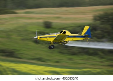 Crop duster spraying a crop, taken using a Panning Technique with motion blur.