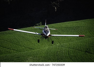 Crop duster working the fields in the Palouse region of southeastern Washington state