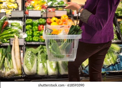 Crop female shopping in grocery store