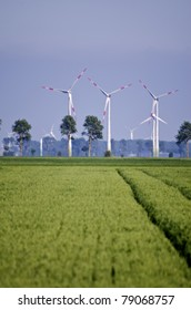 crop fields with wind power stations in the background
