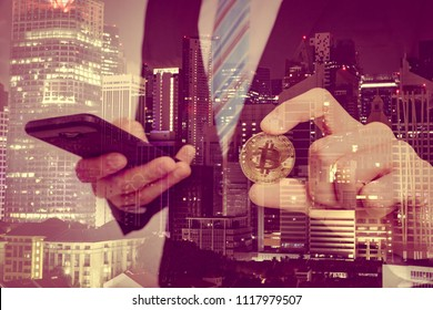 Crop image of Successful young businessman in suit with dollars and bitcoin in hands. Attractive business man hold a lot of dollars on city background. Business, Bitcoin, digital money concept.