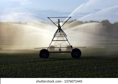 Crop irrigation system spraying water on a farmers field