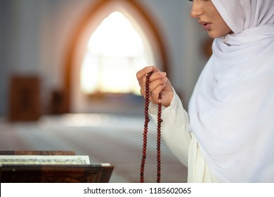 Crop Muslim woman with string of beads