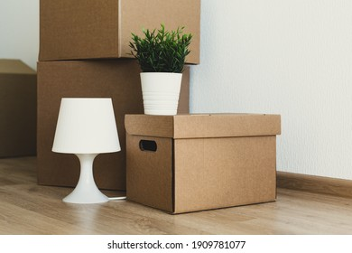 Crop of packaging boxes in apartment, moving concept