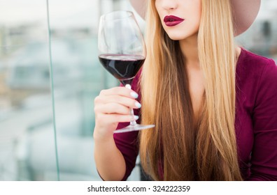 Crop photo,amazing make-up,full lips,red wine,elegant lady,long hairs.Fashion object of sensual lady,tan woman,toned,vintage colors,cool nail polish,nail art,blonde amazing hairstyle,sensual woman