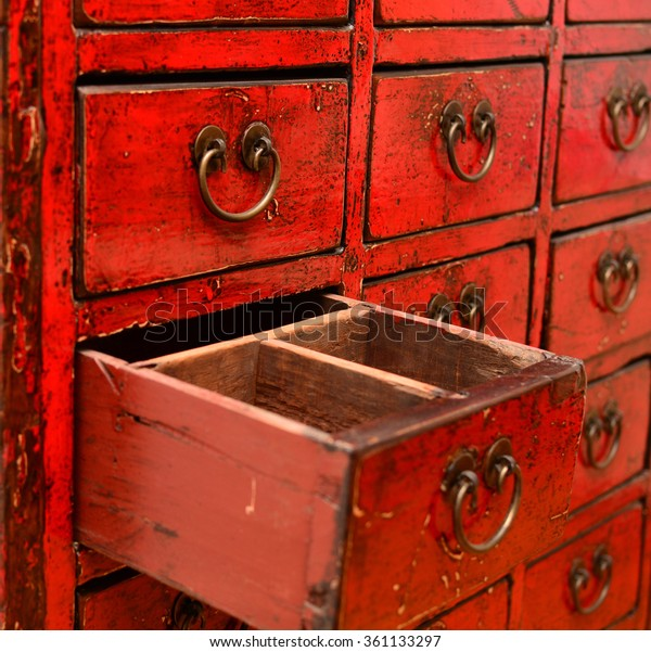 Crop Red Chinese Lacquered Apothecary Cabinet Stock Photo
