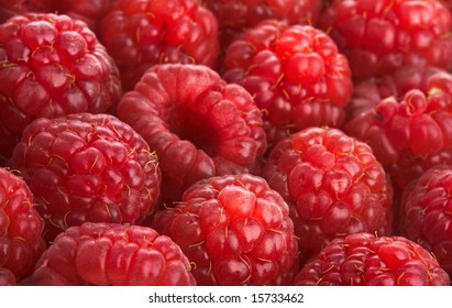 Crop of a red raspberry close up