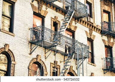 Crop shot of building with emergency stairs.