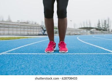 Crop shot of female feet in sportive shoes.