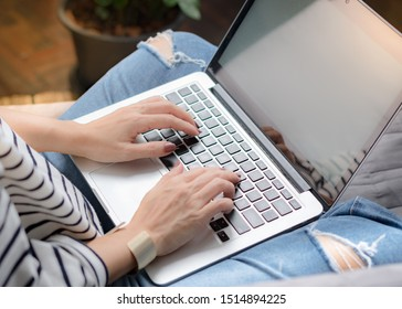Crop shot of a mature woman's hands using computer laptop to manage her online business store. Self-employed, Home-office, Internet technology, Freelance, Blogger, Creative designer, Modern lifestyle.